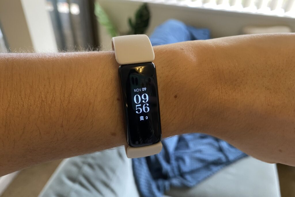 Lunar white Fitbit Inspire 2 on a woman's wrist
