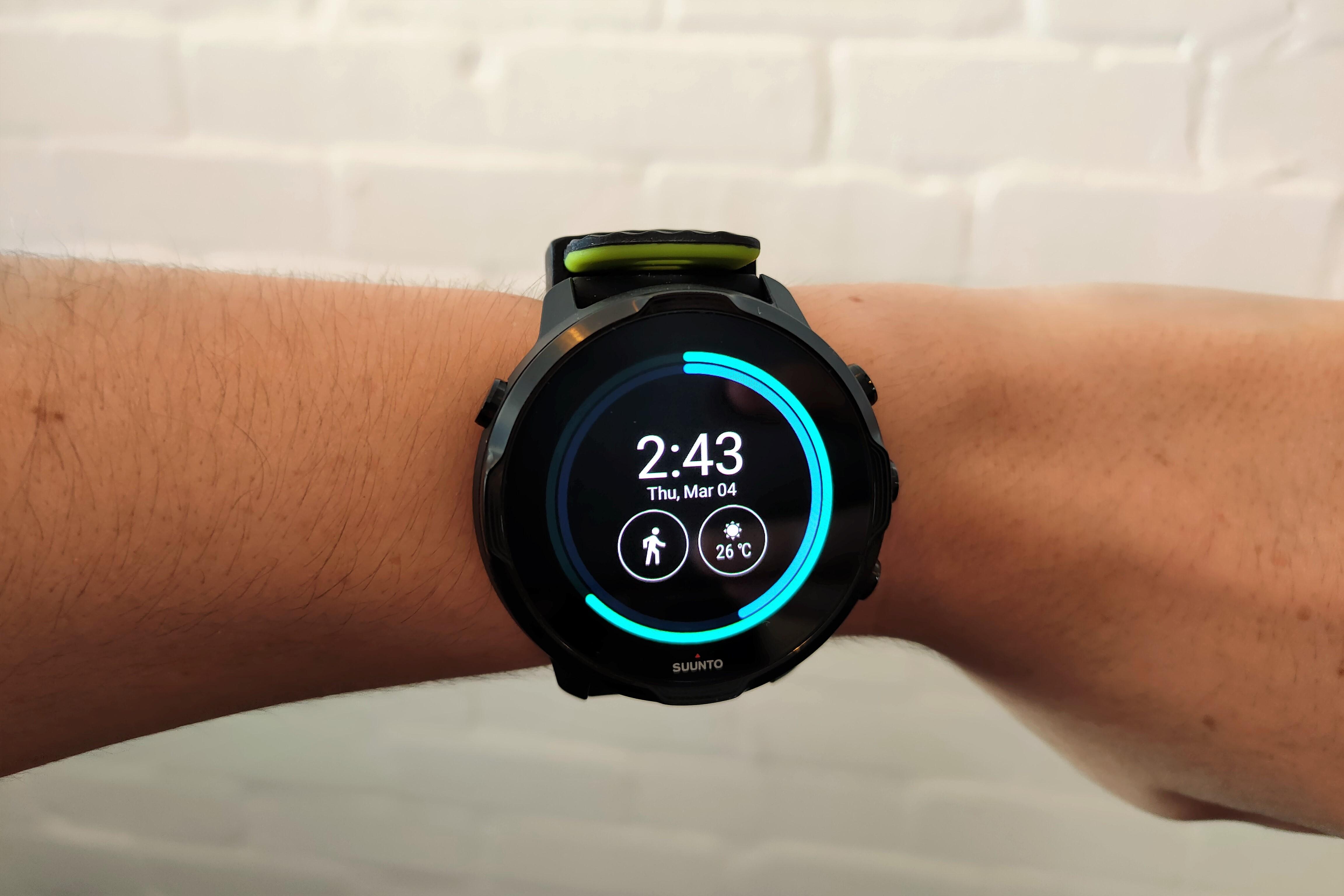 Black Lime Suunto 7 smart watch on a woman's wrist